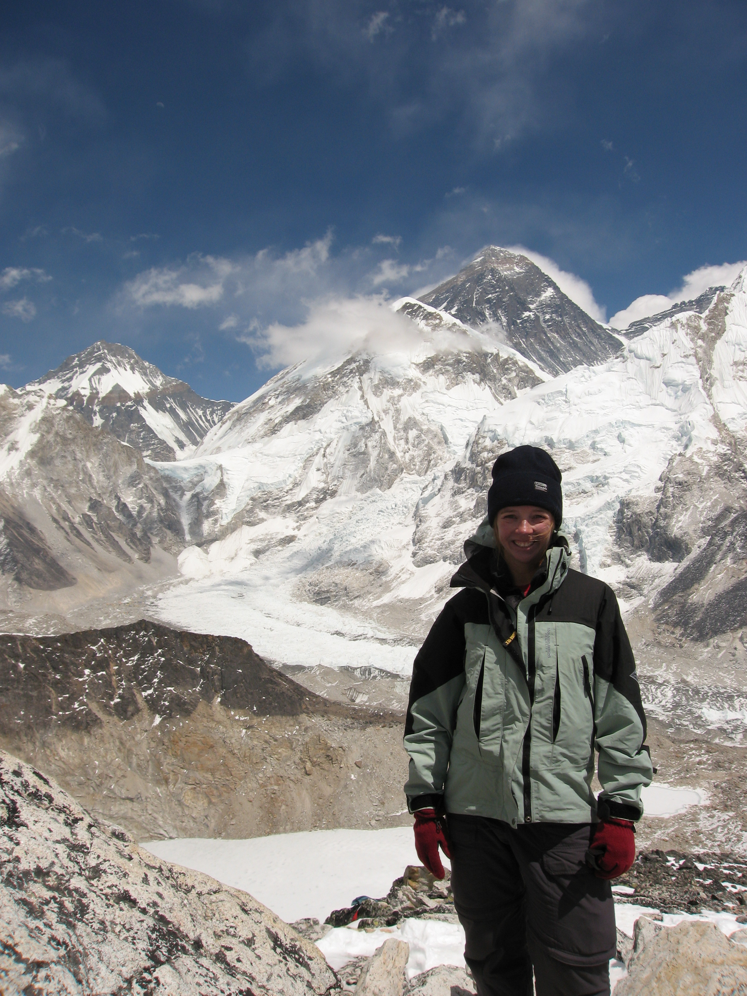 Fiona on the summit of Kala Patar with Everest in the background. Photo Chris Garrard.