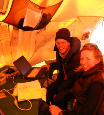 Paul & Fi checking the weather in the communications tent. Photo Mary Adler