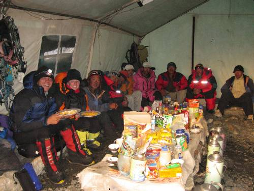 Enjoying dinner with the Sherpas in the camp 2 cook tent. Photo Mingma Sherpa.