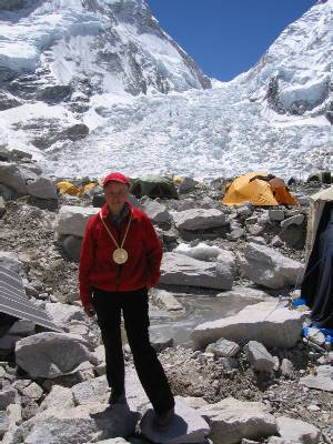 Mary with gold medal at the base of the Khumbu Icefall. Photo Paul Adler.