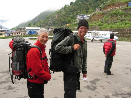 Paul & Mary happy to be walking out to the plane at Lukla airport. Photo Fiona Adler.