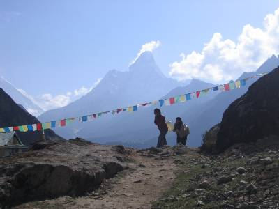 Girls carrying water near Khumjung with Ama Dablam behind them. Photo Fiona Adler.