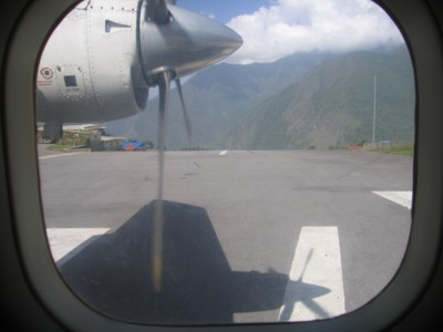 Looking out the window of the plane down the runway. Shortly after this was taken, we spun around 90 degrees and sped of the edge of that ...errr cliff. Photo Paul Adler