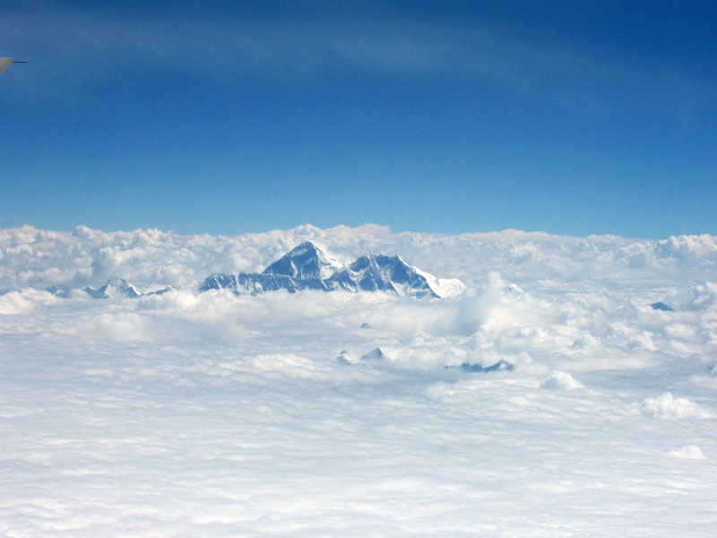 Mt. Everest from our plane at 9500m on our way back to Kathmandu. Photo Paul Adler.