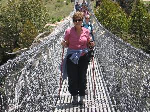 Marg crossing a swing bridge near Phakding. Photo Fiona Adler.