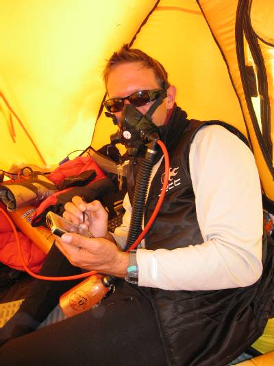 In our tent on the South Col, writing this update. Photo Attila Jelinko.