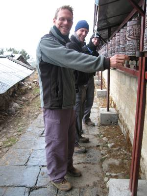Paul, Damien & Tim spinning prayer wheels at Tengboche Monastry. Photo Meagan McGrath.
